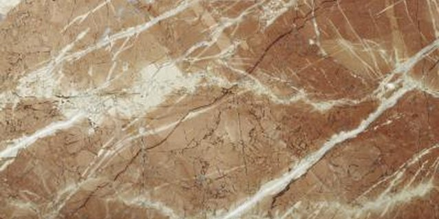 Use a liquid epoxy or stone adhesive to repair a broken marble slab.