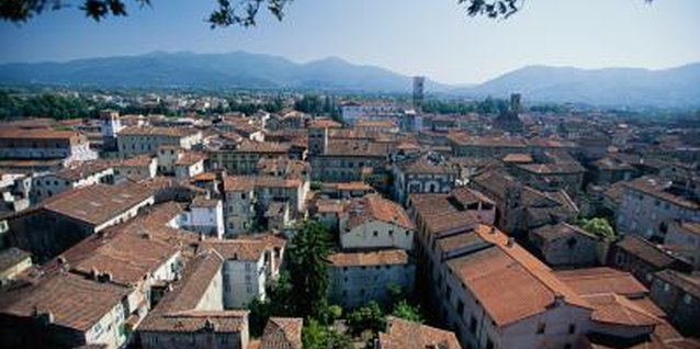 Tuscan red-tiled roofs, like these in Lucca, are emblematic of the style named for this region.