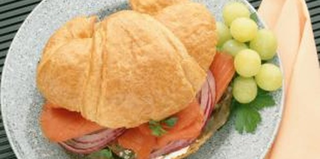Use a light, buttery croissant for a tasty salmon sandwich.