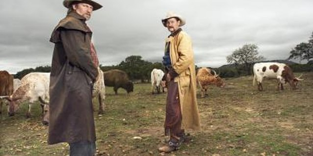 Oilskin coats may be worn by ranchers and other outdoorsmen.