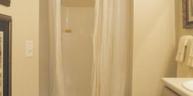 Repurpose drapes into a shower curtain.