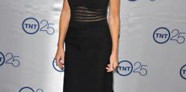 Actress Heather Locklear rocks a black skirt with a sheer black tank top for a monochromatic look.