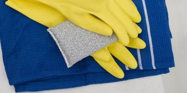 Have gloves and soft cloths on hand when cleaning your bronze faucet.
