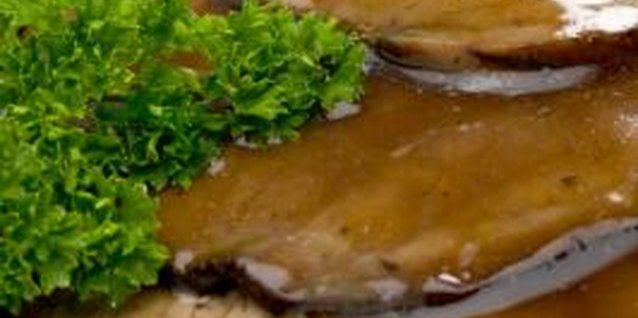Serve roast beef with mashed potatoes and gravy for a traditional meal.