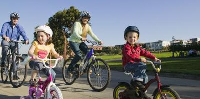 A family bike hike lets you model and teach bicycle safety for your kids.