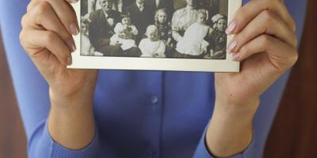 Family pictures may provide clues to your father's relatives.
