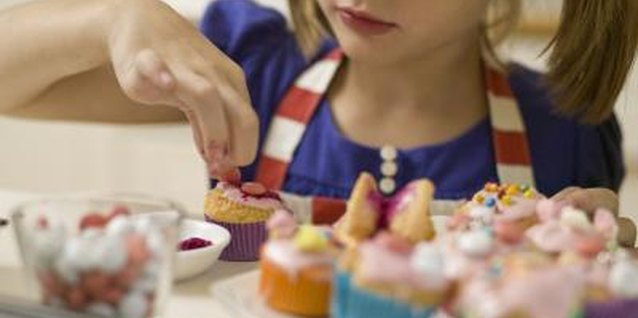 Send the kids home with treats they'll remember by letting each child make a personalized cupcake.