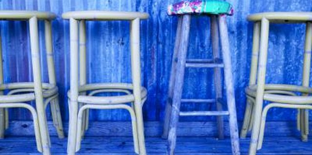 Make old, wooden bar stools cozy and colorful.