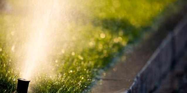 How to Adjust the Spray Coverage of an Impulse Lawn Sprinkler