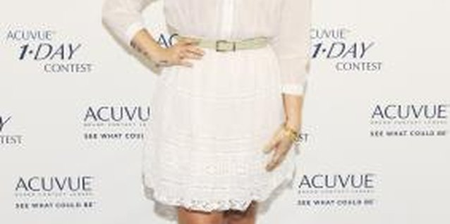 Demi Lovato pairs her brown boots with a white dress for contrast.