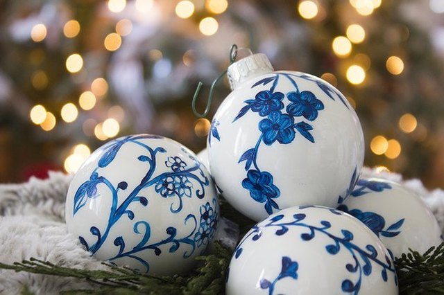 White ball-style tree decorations hand-painted with blue decorative patterns in the style of Chinese porcelain