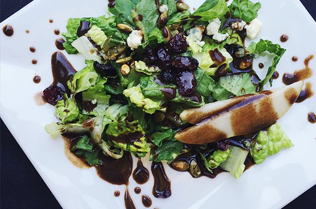 An image of a salad dressed with balsamic vinegar.