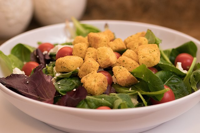 An image of croutons on a salad.