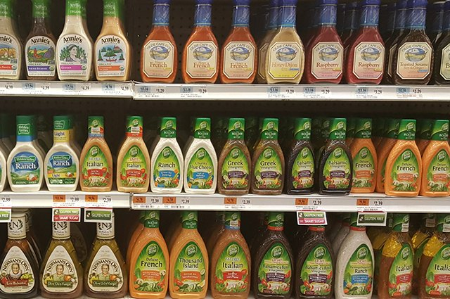An image of dressing on store shelves.