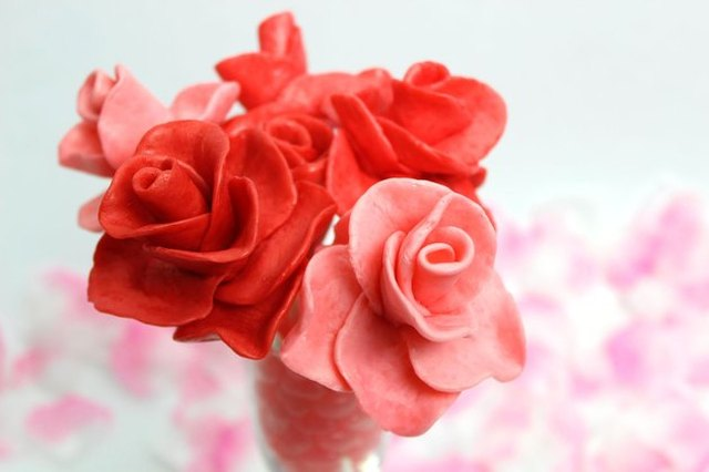 A cluster of pink and red roses made from Starburst Candy, with soft-focus rose petals in the background.