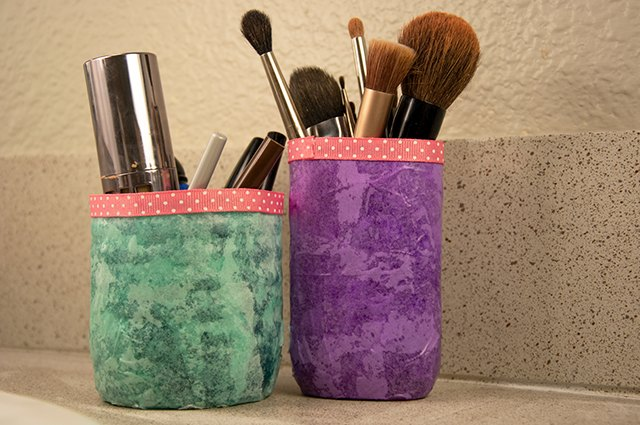 An image of make-up organizers made from old plastic bottles.
