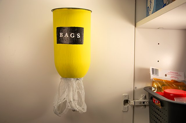 An image of a bag holder made from a 2-liter bottle.