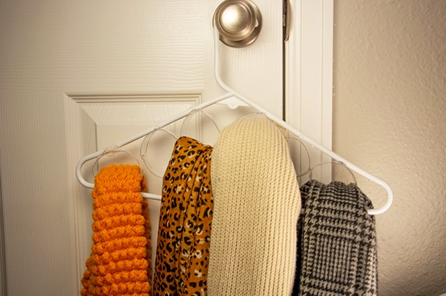 An image of a scarf organizer made from plastic bottles.