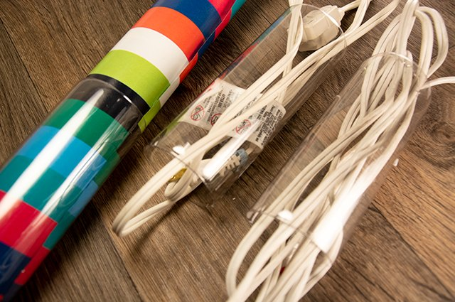 An image of cord and wrapping paper organizers made from plastic bottles.