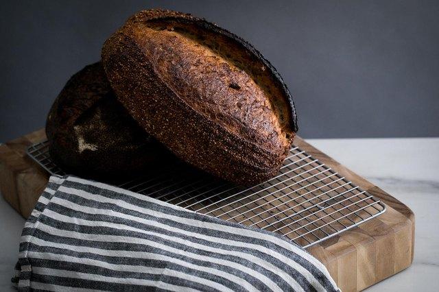 Dark toasted bread on cutting board
