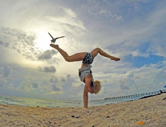 Keri Verna in handstand pose on the beach