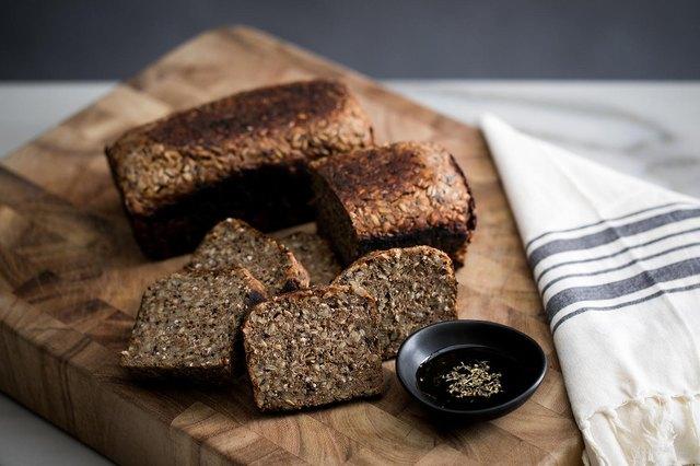 Sliced grain bread on cutting board