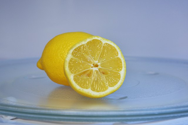 An image of a lemon in a microwave.