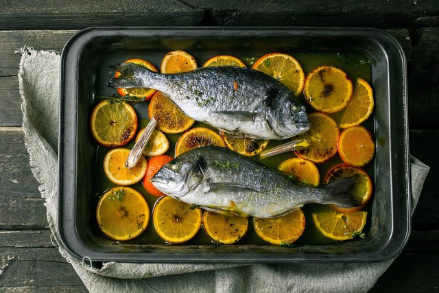 baked fish with oranges and herbs