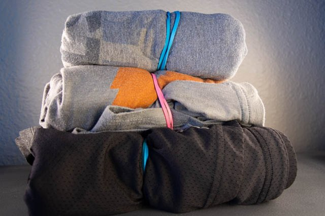 A pyramid of clothes packing hack and rubber band hack