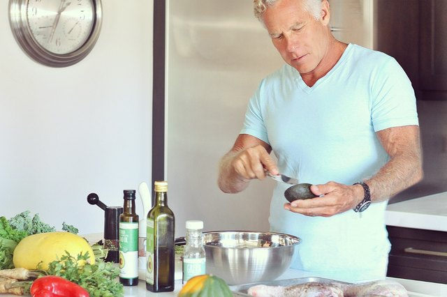 Mark Sisson cooking in his kitchen