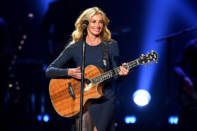 Faith Hill playing guitar on stage in 2017