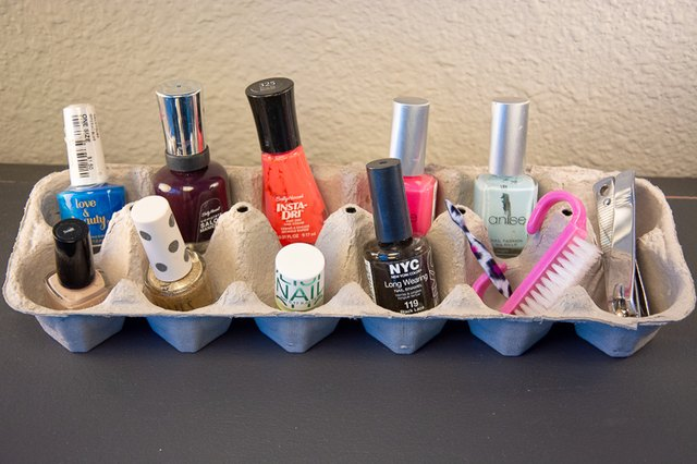 an image of a nail polish holder made from an egg carton