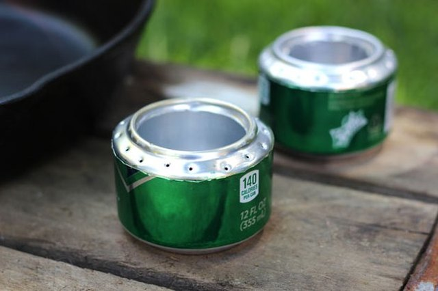 Two soda cans, converted into DIY camp stoves