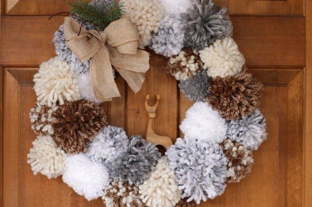 Pom pom wreath on front door