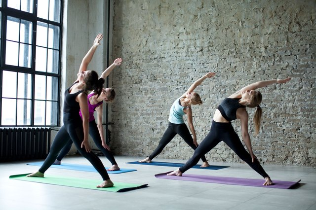 Women in yoga class practicing reverse warrior
