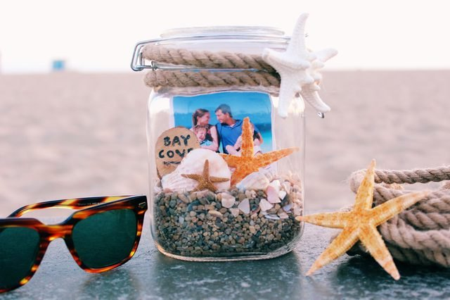 Glass mason jar filled with precious beach memories