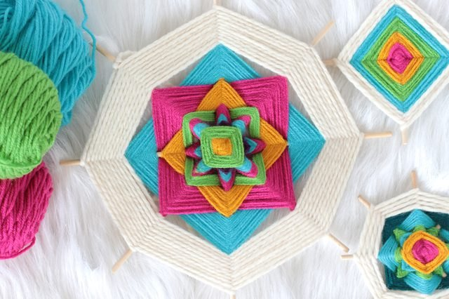 Wooden sticks wrapped in colorful yarn to create a God's eye
