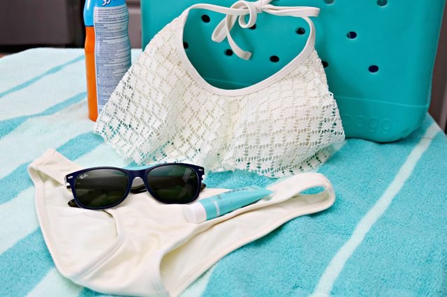 Freshly cleaned bathing suit plus sunnies and sunscreen