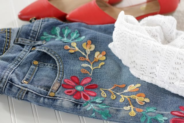 Colorful floral embroidery on denim