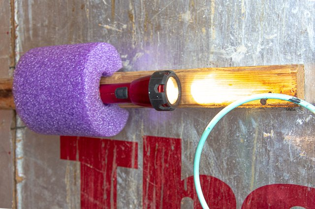turn a pool noodle into a flashlight holder