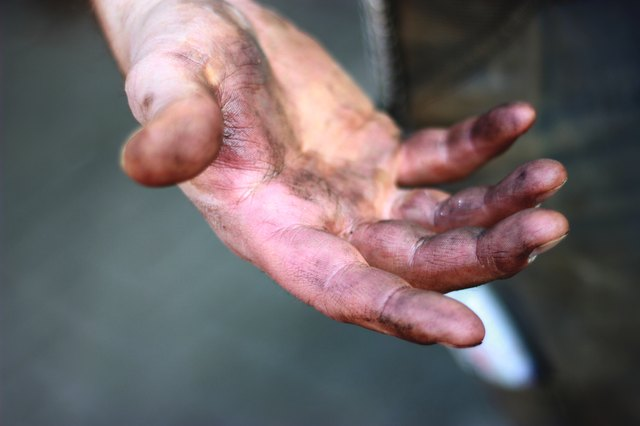 Dirty hands from a construction worker