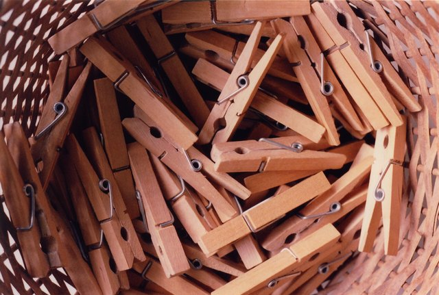 Directly Above Shot Of Clothespins In Wicker Basket