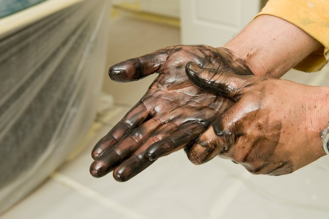 Painter Washing Stained Hands with Lacquer Thinner