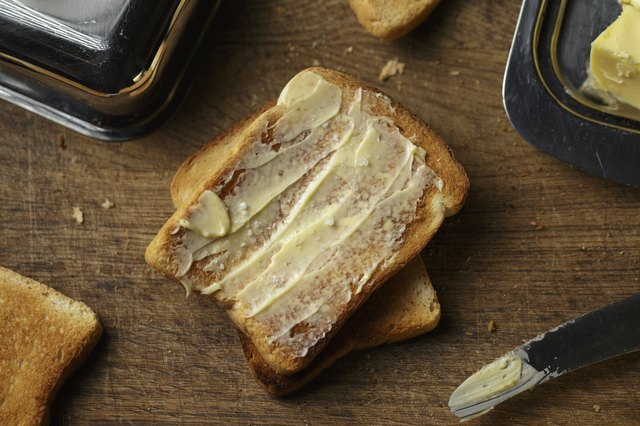 Crust toast bread and butter on a wooden background