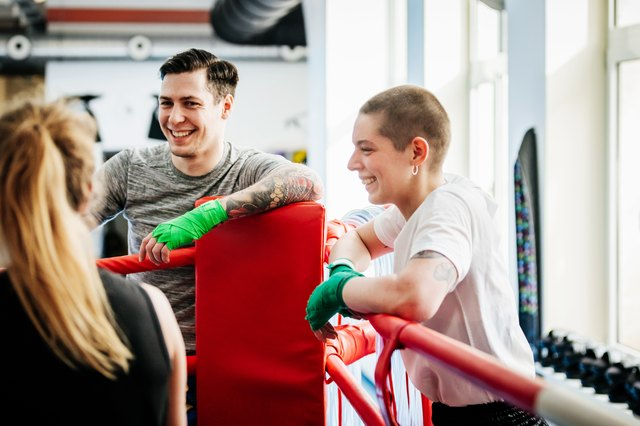 Kickboxers Hanging Out Together At Local Gym