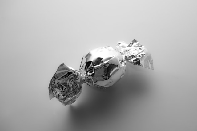 High Angle View Of Candy On Gray Background