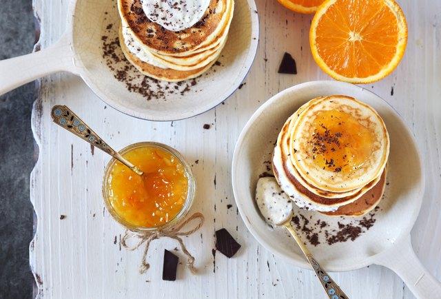 Ricotta pancakes with orange jam and chocolate