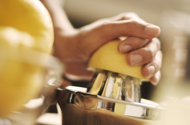 A woman juices a lemon by hand, Switzerland, Europe.
