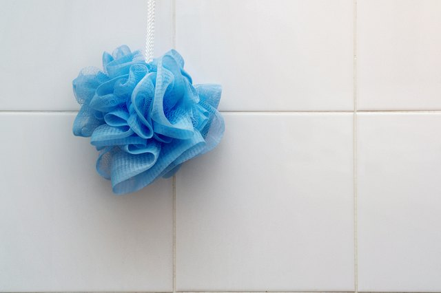 Close-Up Of Loofah Hanging On Wall At Home