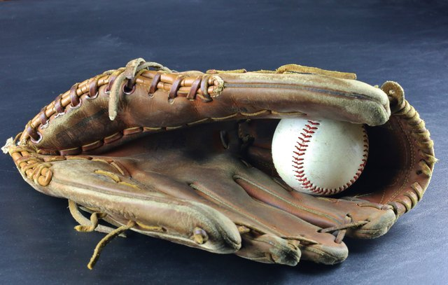 Baseball mitt with hard ball